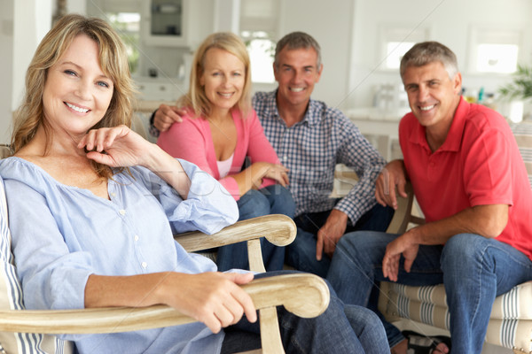 Mid age couples relaxing at home Stock photo © monkey_business