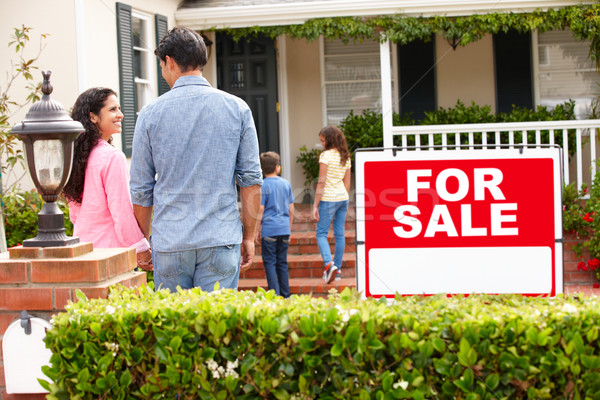 Hispanic family outside home with for sale sign Stock photo © monkey_business