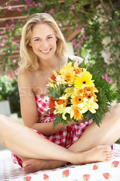 Woman Holding Bunch Of Flowers Stock photo © monkey_business