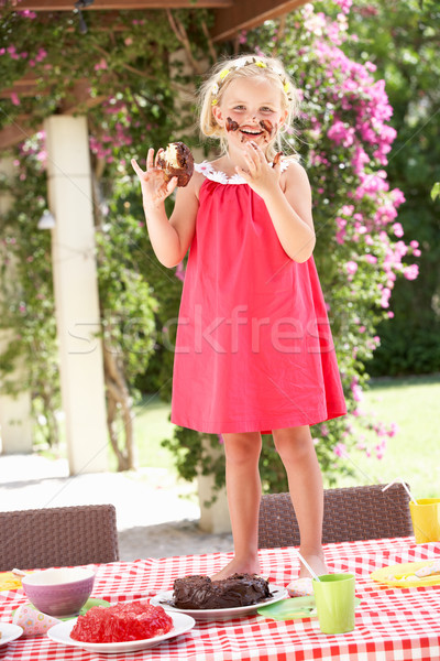 Girl Eating Jelly And Cake At Outdoor Tea Party Stock photo © monkey_business