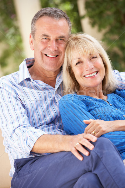 Stock photo: Senior Couple Relaxing On Sofa At Home