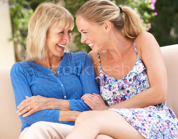Idős nő felnőtt lánygyermek megnyugtató kanapé Stock fotó © monkey_business