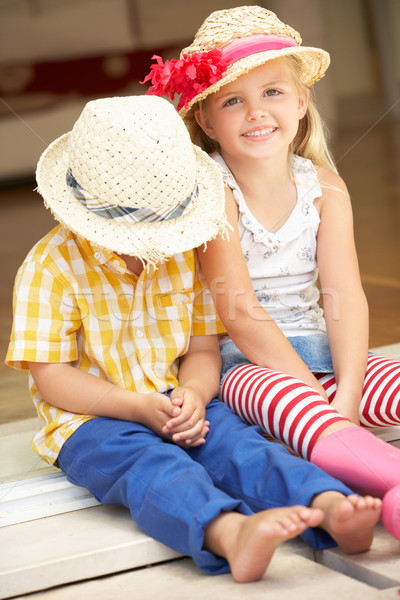 Stock photo: Two Children Sitting Outside House