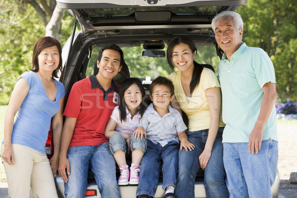 Extended family sitting in tailgate of car Stock photo © monkey_business