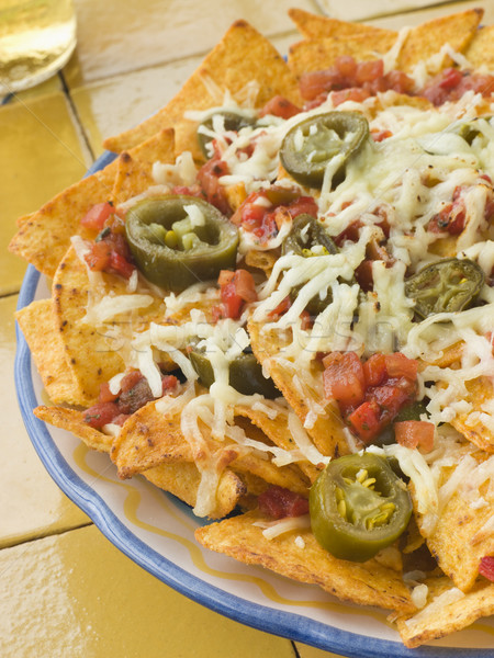 Platter of Nachos with Salsa Jalapenos and Cheese Stock photo © monkey_business