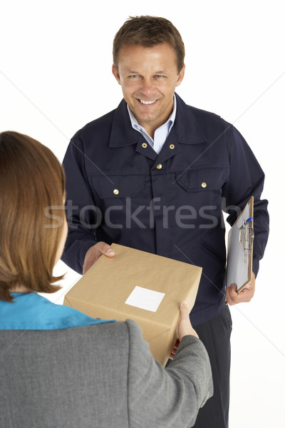 Courier Handing Over A Parcel To An Office Worker Stock photo © monkey_business