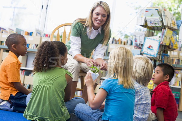 Kindergarten teacher and children looking at seedling in library Stock photo © monkey_business