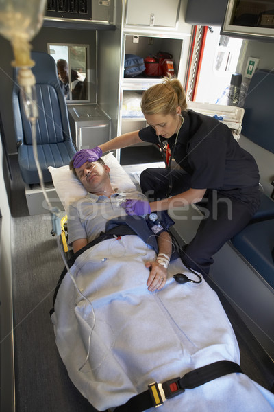 Paramedic with patient in ambulance Stock photo © monkey_business