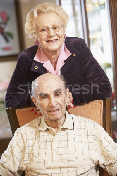 Senior couple relaxing in armSenior couple relaxing in armchairs Stock photo © monkey_business