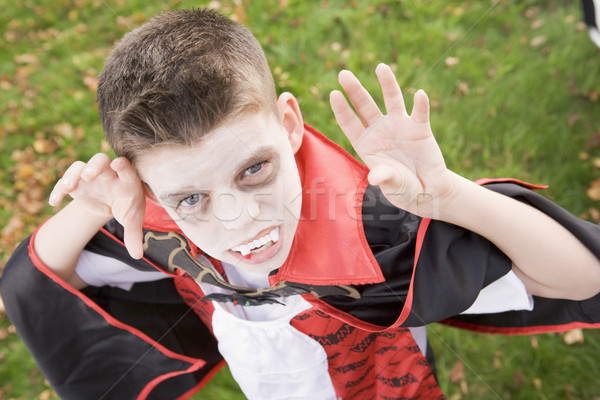 Stock photo: Young boy outdoors wearing vampire costume on Halloween