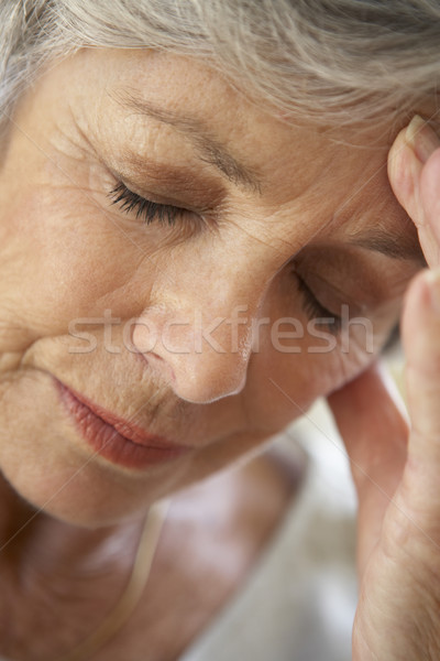 Senior Woman With Head In Hands Looking Weary Stock photo © monkey_business