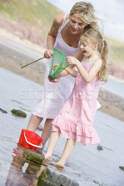 Stock photo: Mother and daughter at beach fishing and smiling