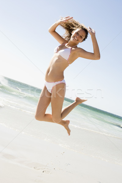 Woman leaping on beach Stock photo © monkey_business