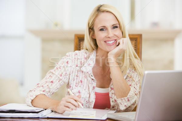 Mulher sala de jantar laptop computador mulheres feliz Foto stock © monkey_business