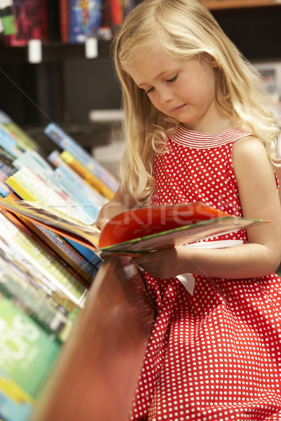 Young girl in bookshop Stock photo © monkey_business