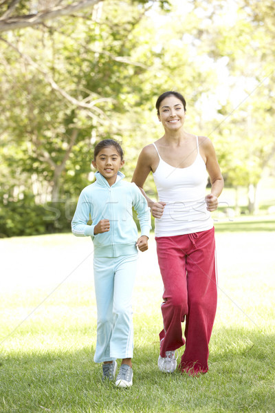 Mother And Daughter Exercising In Park Stock photo © monkey_business