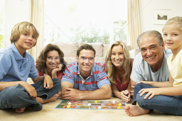 Family Playing Board Game At Home With Grandparents Watching Stock photo © monkey_business