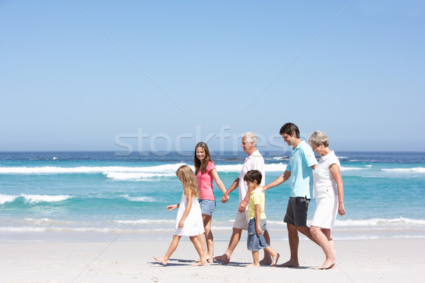 Three Generation Family Walking Along Sandy Beach Stock photo © monkey_business