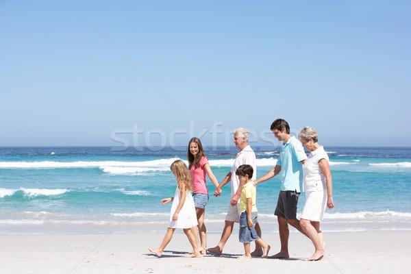 Három generáció család sétál homokos tengerpart nő Stock fotó © monkey_business