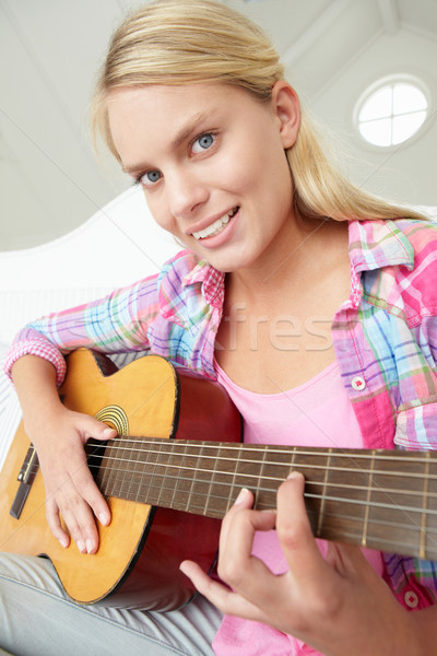 Teenage girl playing acoustic guitar Stock photo © monkey_business