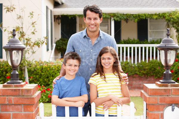 Father and children outside home Stock photo © monkey_business
