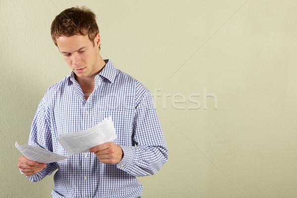 Studio Shot Of Young Man Looking at Bills Stock photo © monkey_business