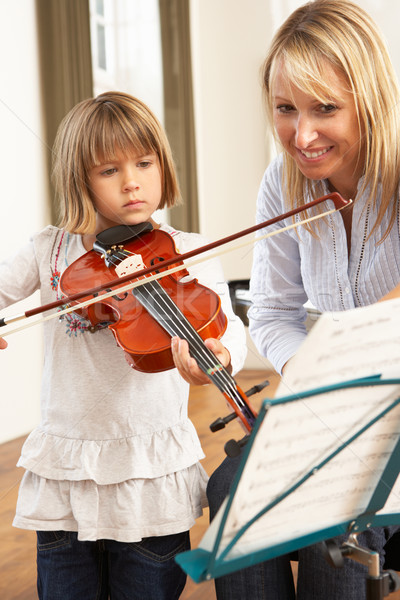 Young girl playing violin in music lesson Stock photo © monkey_business