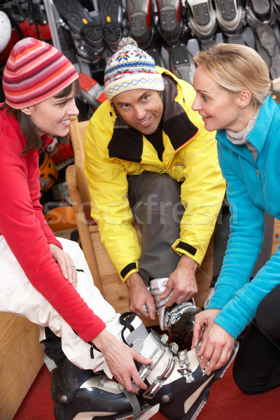 Sales Assistant Helping Couple To Try On Ski Boots In Hire Shop Stock photo © monkey_business