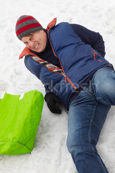 Man Slipped And Injured Back On Icy Street Stock photo © monkey_business