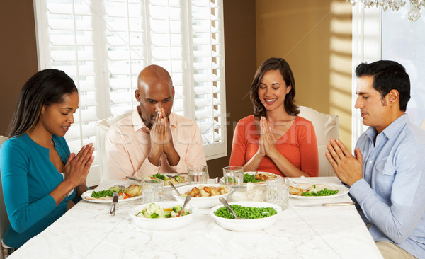 Group Of Friends Saying Grace Before Meal At Home Stock photo © monkey_business