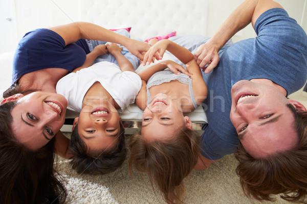 Család fejjel lefelé ágy pizsama együtt lány Stock fotó © monkey_business