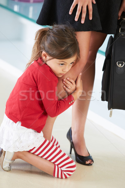 Daughter Clinging To Working Mother's Leg Stock photo © monkey_business