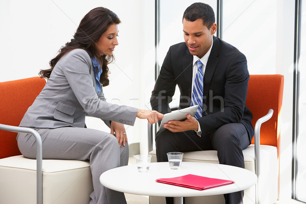 Businessman And Businesswoman Having Informal Office Meeting Stock photo © monkey_business