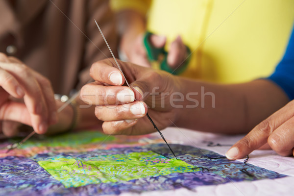 Close Up Of Woman's Hand Sewing Quilt Stock photo © monkey_business