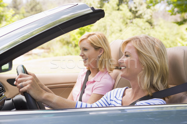 Two women in convertible car smiling Stock photo © monkey_business