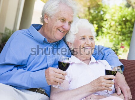 Senior couple drinking red wine Stock photo © monkey_business