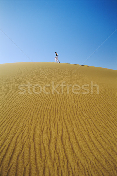 Woman walking across desert sand dune Stock photo © monkey_business