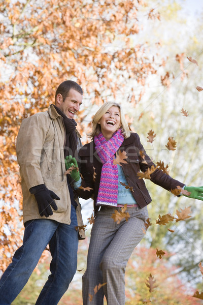 Young couple having throwing leaves in the air Stock photo © monkey_business