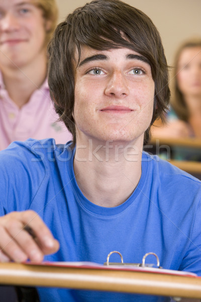 Male college student listening to a university lecture Stock photo © monkey_business
