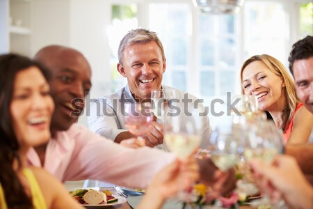 Man Preparing Food For Dinner Party Stock photo © monkey_business