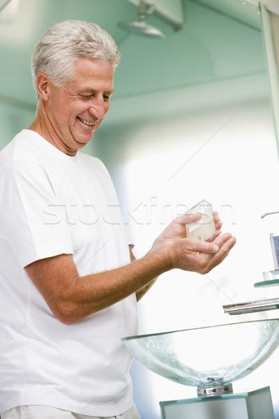 Homem banheiro loção após barba sorridente beleza Foto stock © monkey_business