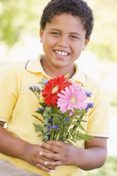 Stok fotoğraf: çiçekler · gülen · çim · mutlu
