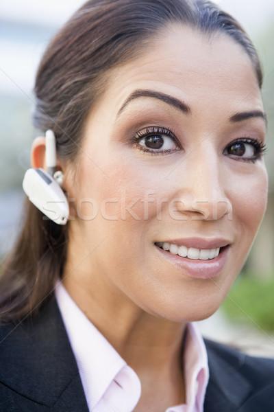Femme d'affaires bluetooth technologie portrait communication Homme Photo stock © monkey_business