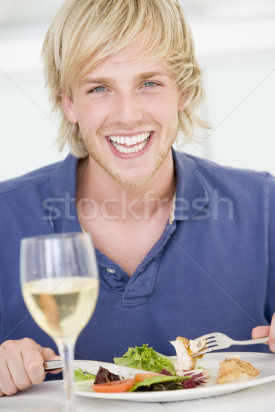 Young Man Enjoying meal,mealtime With A Glass Of Wine Stock photo © monkey_business