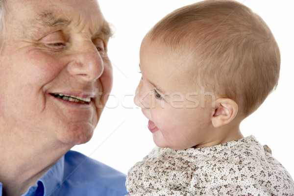 Portrait of grandfather and granddaughter, smiling at each other Stock photo © monkey_business