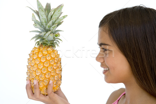 Young girl holding pineapple and smiling Stock photo © monkey_business