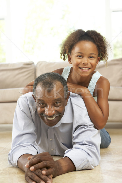 Stock photo: Grandfather And Granddaughter Playing Together At Home