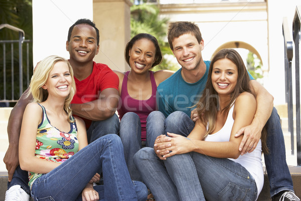 Group Of Friends Sitting On Steps Of Building Stock photo © monkey_business