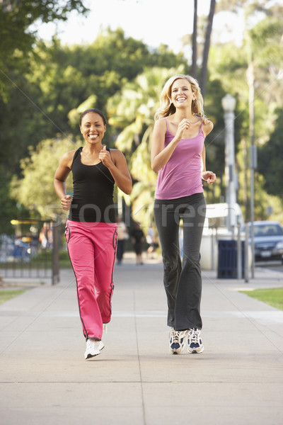 Two Female Friends Jogging On Street Stock photo © monkey_business