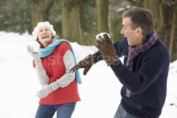 Senior Couple Having Snowball Fight In Snowy Woodland Stock photo © monkey_business